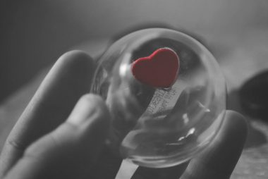 selective color of red heart ball photography